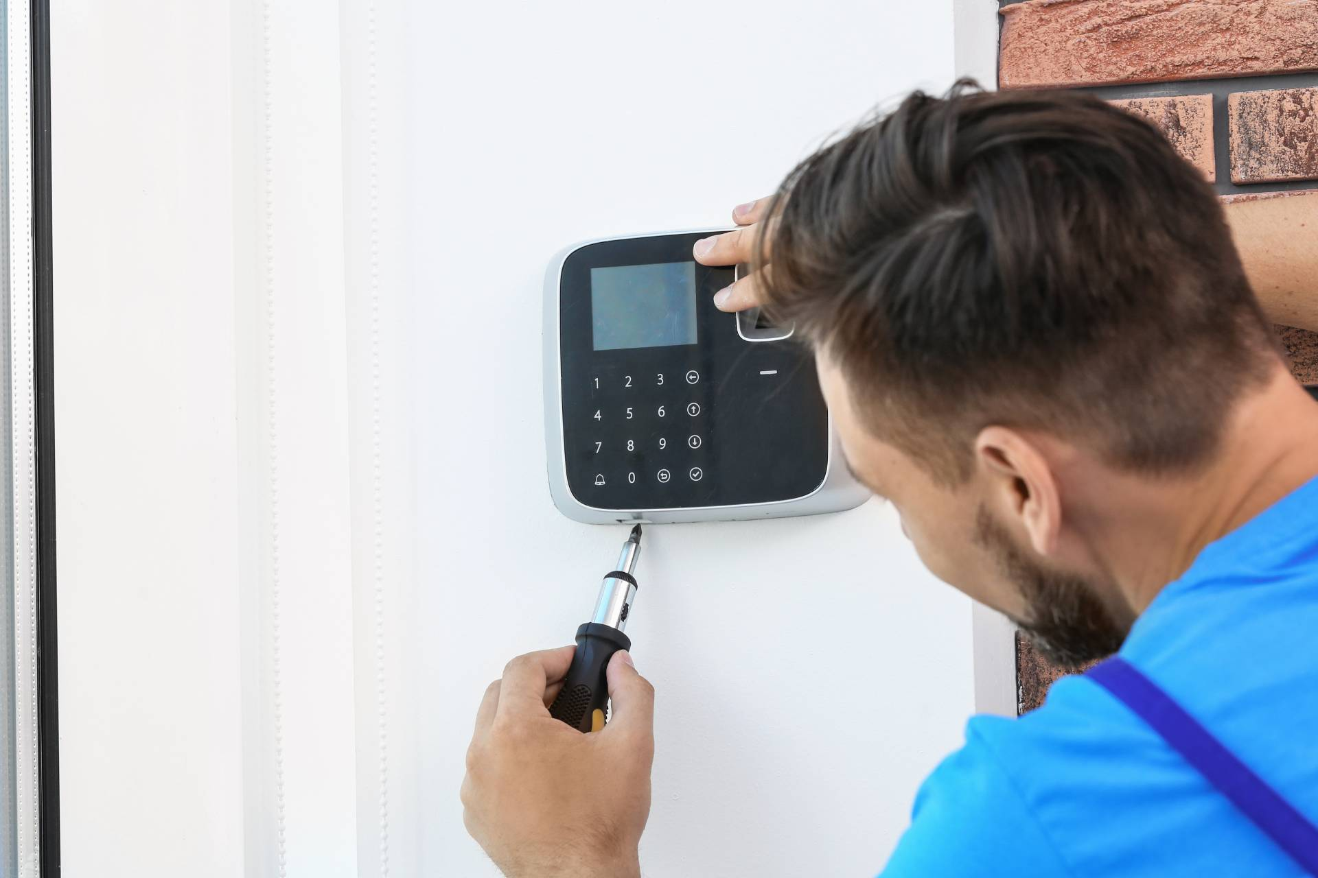 man installing security system